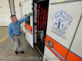 Anniversary Committee Chairman Philip Gingerella wipes smudges off the new ambulance while he and fellow members of the committee prepare for the 100th anniversary ceremony of The Westerly Ambulance Corps at their headquarters Friday, Jan. 6, 2017. The ambulance later was draped in black plastic to be unveiled during the ceremony. (Dana Jensen/The Day)
