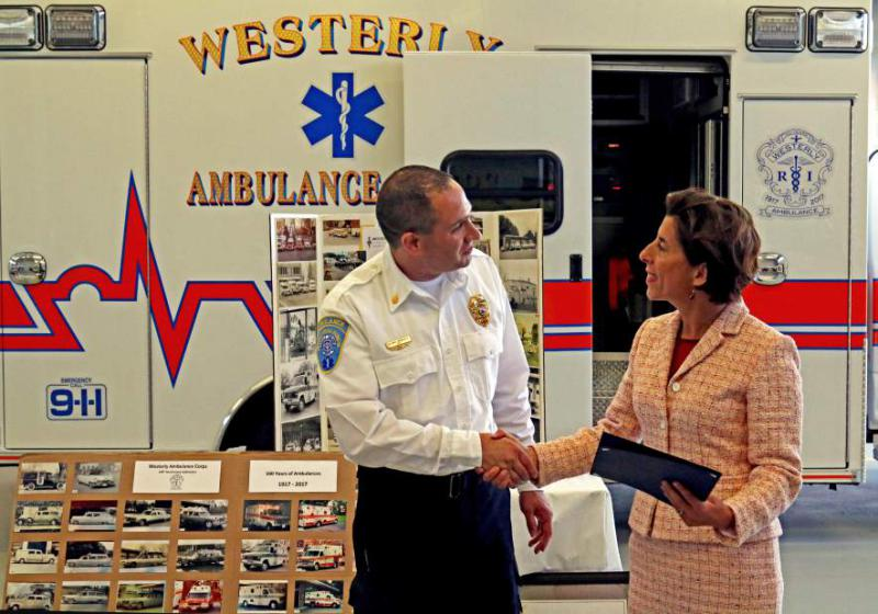 Westerly Ambulance Asst. Chief Michael Brancato thanks Gov. Gina Raimondo on Friday, Sept. 8th, 2017, following her brief tour of the facility. The governor's visit was in recognition of the Westerly Ambulance Corps 100th anniversary.| Harold Hanka, The Westerly Sun