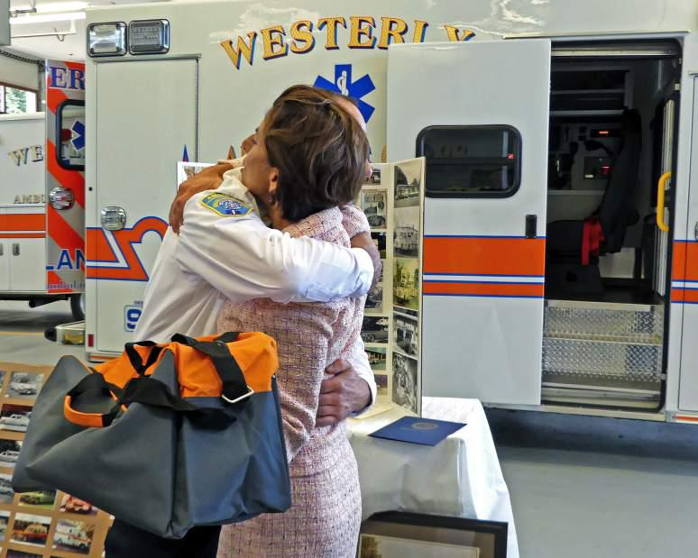 Westerly Ambulance Asst. Chief Michael Brancato hugs Gov. Gina Raimondo on Friday, Sept. 8th, 2017, following her brief tour of the facility. The governor's visit was in recognition of the Westerly Ambulance Corps 100th anniversary.| Harold Hanka, The Westerly Sun