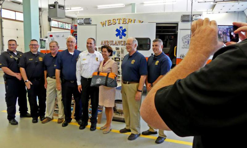 Gov. Gina Raimondo poses for a group with members of the Westerly Ambulance Corps on Friday, Sept. 8th, 2017, following her brief tour of the facility. The governor's visit was in recognition of the Corps 100th anniversary.| Harold Hanka, The Westerly Sun