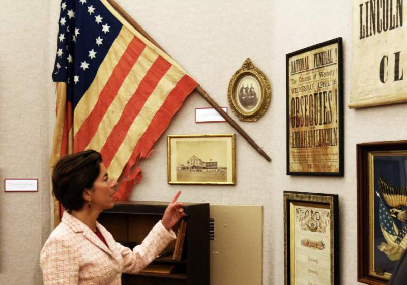 Gov. Gina Raimondo examines items in the Treasures Through Time exhibit in the Hoxie Gallery at the Westerly Library during a brief tour guided by Brigitte Hopkins, the library's Executive Director on Friday, Sept. 8th, 2017. The governor visit was to recognize the library's 125th anniversary. She also stopped by the Westerly Ambulance Corps to recognize its 100th anniversary.| Harold Hanka, The Westerly Sun