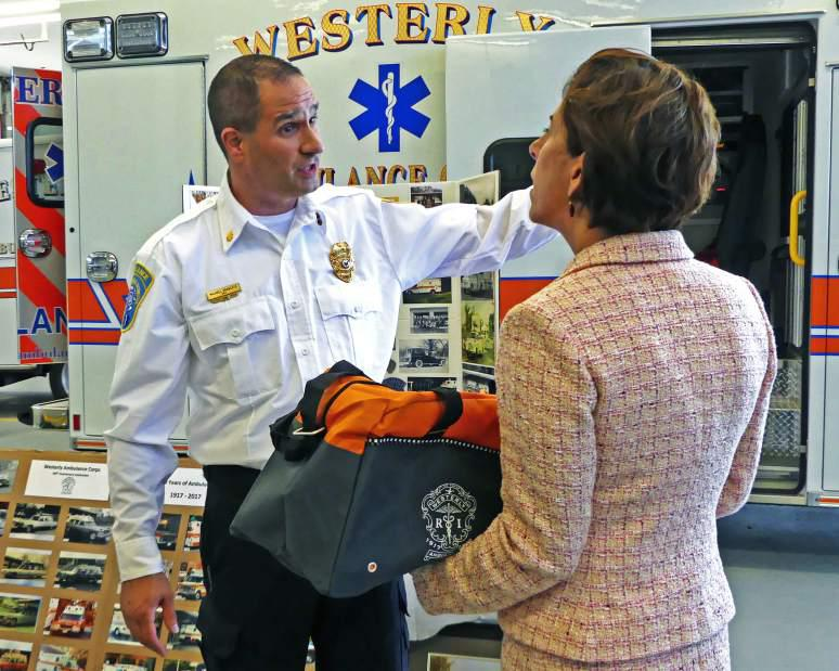 Westerly Ambulance Asst. Chief Michael Brancato talks with Gov. Gina Raimondo on Friday, Sept. 8th, 2017, during her brief tour of the facility. The governor's visit was in recognition of the Westerly Ambulance Corps 100th anniversary.| Harold Hanka, The Westerly Sun