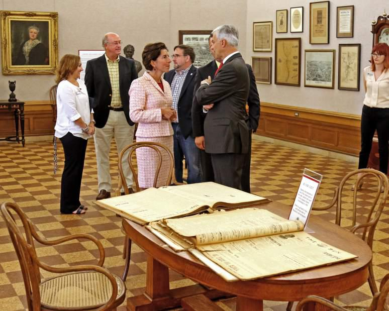 Gov. Gina Raimondo chats with State Sen. Dennis Algiere while viewing the Treasures Through Time exhibit in the Hoxie Gallery at the Westerly Library during a brief tour guided by Brigitte Hopkins, the library's Executive Director on Friday, Sept. 8th, 2017. The governor visit was to recognize the library's 125th anniversary. She also stopped by the Westerly Ambulance Corps to recognize its 100th anniversary.| Harold Hanka, The Westerly Sun