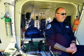 Paramedic Burt Cox handles the back of the Lifestar helicopter. The Westerly Ambulance Corps celebrates 100 years of service at the Chestnut Street location on Saturday, September 23, 2017. The event includes facility tours, food, drink, activities for children, demonstrations of CPR, and a visit from Hartford Hospital's Lifestar Helicopter. | Anna Sullivan, The Westerly Sun