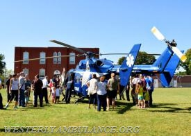 The Westerly Ambulance Corps celebrated 100 years of service at an open house Saturday at its Chestnut Street headquarters. There were tours, food, activities for children, CPR demonstrations, and a visit from Hartford Hospital's Life Star helicopter. | Anna Sullivan, The Westerly Sun
