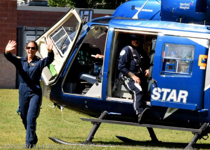 Laura Thomasson, an RN with Hartford Hospital, waved to the crowd after arriving in the Life Star helicopter.   Anna Sullivan, The Westerly Sun