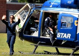 Laura Thomasson, an RN with Hartford Hospital, waved to the crowd after arriving in the Life Star helicopter. | Anna Sullivan, The Westerly Sun