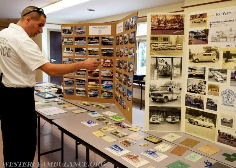 Assistant Chief Michael Brancato points out some of the photos of the old ambulances on the storyboards that are displayed as the Westerly Ambulance Corps celebrates 100 years of service at the Chestnut Street location on Saturday, September 23, 2017. The event includes facility tours, food, drink, activities for children, demonstrations of CPR, and a visit from Hartford Hospital's Lifestar Helicopter.   Anna Sullivan, The Westerly Sun