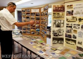 Assistant Chief Michael Brancato points out some of the photos of the old ambulances on the storyboards that are displayed as the Westerly Ambulance Corps celebrates 100 years of service at the Chestnut Street location on Saturday, September 23, 2017. The event includes facility tours, food, drink, activities for children, demonstrations of CPR, and a visit from Hartford Hospital's Lifestar Helicopter. | Anna Sullivan, The Westerly Sun