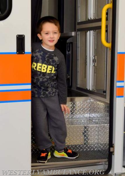 C.J. Johnson, 5, of Westerly, climbs on an ambulance. The Westerly Ambulance Corps celebrates 100 years of service at the Chestnut Street location on Saturday, September 23, 2017. The event includes facility tours, food, drink, activities for children, demonstrations of CPR, and a visit from Hartford Hospital's Lifestar Helicopter.   Anna Sullivan, The Westerly Sun