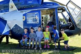 Children don't miss the chance to sit on the railing of the Lifestar Helicopter. Left to right are: Devin O'Reilly, Eli Davila, Derien Northup, Leah, Paul and Colton Latimer. All are from Westerly. The Westerly Ambulance Corps celebrates 100 years of service at the Chestnut Street location on Saturday, September 23, 2017. The event includes facility tours, food, drink, activities for children, demonstrations of CPR, and a visit from Hartford Hospital's Lifestar Helicopter. | Anna Sullivan, The Westerly Sun