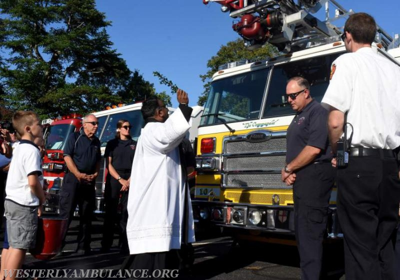 Rev. Sunil Chandy of Christ Church blesses a Misquamicut Fire Department truck at a service blessing first responders and their vehicles in the parking lot of Central Baptist Church in Westerly on Sunday, September 24, 2017 followed by a procession to Christ Church for an interfaith blessing service. This event is organized by Rev. Cal Lord of Central Baptist Church and Rev. Sunil Chandy of Christ Church and other Faith leaders. | Christine Corrigan, The Westerly Sun