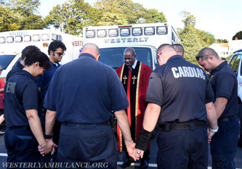 Pastor Mal Davis of Pleasant Street Baptist Church in Westerly leads members of the Westerly Ambulance Corps in prayer at a blessing of the first responders service in the parking lot of Central Baptist Church in Westerly on Sunday, September 24, 2017 followed by a procession to Christ Church for an interfaith blessing service.This event is organized by Rev. Cal Lord of Central Baptist Church and Rev. Sunil Chandy of Christ Church and other Faith leaders. | Christine Corrigan, The Westerly Sun
