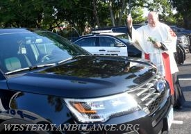 Rev. Thomas F.X. Hoar of Enders Island Retreat in Mystic blesses a Stonington Police vechicle at a service blessing first responders and their vehicles in the parking lot of Central Baptist Church in Westerly on Sunday, September 24, 2017 followed by a procession to Christ Church for an interfaith blessing service. This event is organized by Rev. Cal Lord of Central Baptist Church and Rev. Sunil Chandy of Christ Church and other Faith leaders. | Christine Corrigan, The Westerly Sun