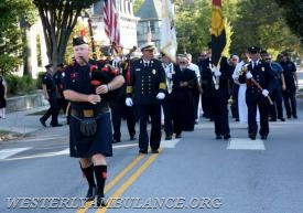 Bagpiper Russell Hayes of the University of Rhode Island Police Department leads a procession of first responders and clergy on Elm Street to Christ Church in Westerly for for an interfaith blessing service on Sunday, September 24, 2017. A service took place before the procession blessing first responders and their vehicles in the parking lot of Central Baptist Church.This event is organized by Rev. Cal Lord of Central Baptist Church and Rev. Sunil Chandy of Christ Church and other Faith leaders. | Christine Corrigan, The Westerly Sun