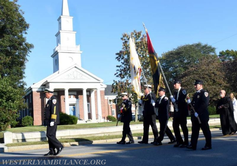 The Hopkins Hills Fire Department Honor Guard of Coventry, Rhode Island marches in a procession on Elm Street to Christ Church in Westerly for an interfaith blessing service for first responders on Sunday, September 24, 2017. A service took place before the procession blessing first responders and their vehicles in the parking lot of Christ Church. This event is organized by Rev. Cal Lord of Central Baptist Church and Rev. Sunil Chandy of Christ Church and other Faith leaders. Vehicles were blessed in a service in the parking lot of Central Baptist Church in Westerly on Sunday, September 24, 2017. | Christine Corrigan, The Westerly Sun
