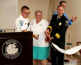 Ken Richards III, Westerly Ambulance Corps EMS administrator, CTE Medical Pathways instructor Dawn Smith, and Michael Brancato, assistant chief of the ambulance corps, cut the ribbon for the new career program on Tuesday.Harold Hanka, The Westerly Sun