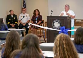 CTE Medical Pathways Instructor Dawn Smith addresses students and guests at the ceremonial ribbon cutting for the Westerly Public Schools CTE-Medical Pathways Program at the Westerly Ambulance Corps headquarters on Tuesday September 4, 2018. Looking on are Westerly Ambulance Asst. Chief Michael Brancato, Ken Richards III, EMS administrator for the Westerly Ambulance Corps, and Nicole DePailito, representing Westerly Hospital. Harold Hanka, The Westerly Sun