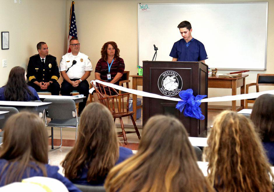 CTE Medical Pathways student Mathieu Brissette addresses students and guests at the ceremonial ribbon cutting for the Westerly Public Schools CTE-Medical Pathways Program at the Westerly Ambulance Corps headquarters on Tuesday September 4, 2018. Looking on are Westerly Ambulance Asst. Chief Michael Brancato, Ken Richards III, EMS administrator for the Westerly Ambulance Corps, and Nicole DePailito, representing Westerly Hospital. Harold Hanka, The Westerly Sun
