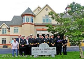 Members of the Westerly Ambulance Corps gather for a group photo following the memorial service at the Westerly Ambulance Corps  on Friday, June 21, 2019.  Photo by Harold Hanka, The Westerly Sun